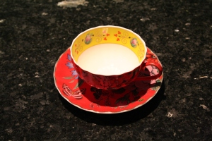 red cup n saucer