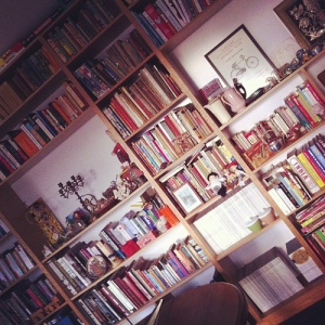 Bookshelf in front room after tidying.